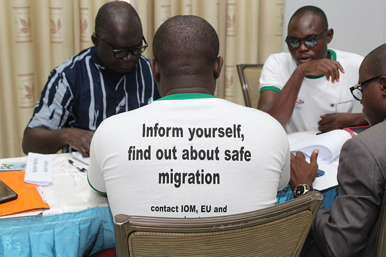 A group of young journalists from Ghana sitting at a conference at a training session for journalists on how to handle topics of irregular migration.